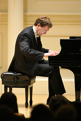U.S. and European-trained classical concert pianist Yevgeny Morozov, based in Central New Jersey, has a wide and varied repertoire that includes the most challenging and technically demanding solo piano works.